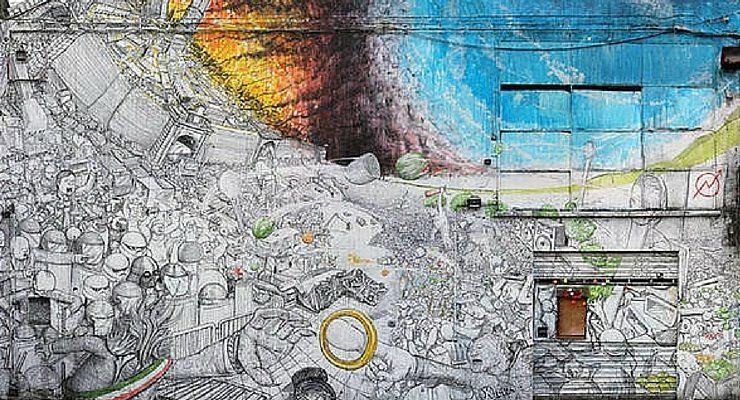 Lo street artist Blu cancella per protesta le sue opere dai muri di Bologna
