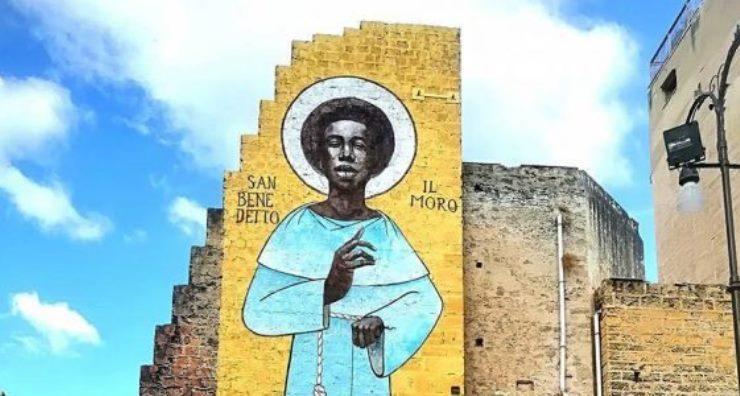 Un santo africano sui muri di Palermo, la città che ama i migranti