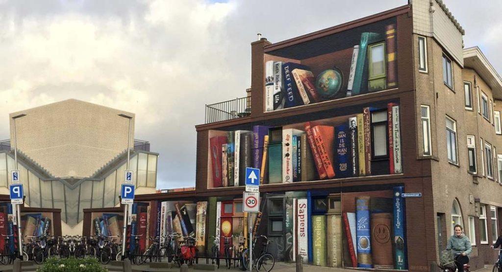 Street art, in Olanda il muro di un palazzo diventa una libreria