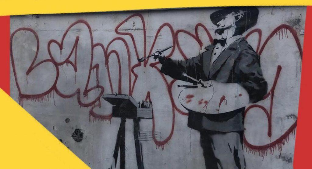 Il pittore di graffiti, il murale di Banksy a Notting Hill